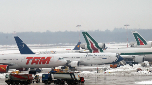 Planes are parked at Malpensa airport co