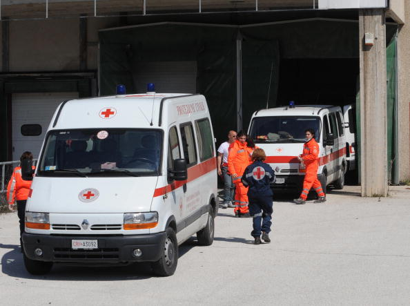 Red Cross' ambulances carry bodies to a