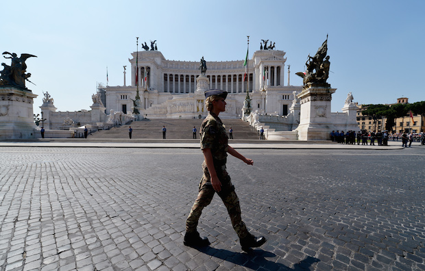 An Italian soldier marches in front of t