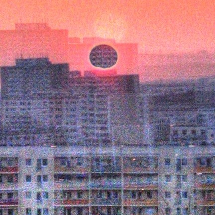 black square sun hypeЯReally eclipsed through layers of social housing blocks_flickr_quapan