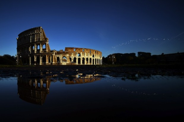 ITALY-TOURISM-FEATURE-COLOSSEUM