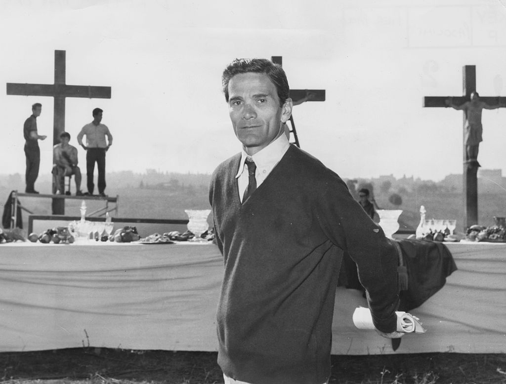 Italian director Pier Paolo Pasolini in front of a biblical scene during the filming of 'The Gospel as Mattheus', circa 1962. Printed following the murder of Pasolini in November 1975. (Photo by Keystone/Hulton Archive/Getty Images)