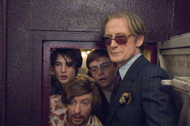 Tom Sturridge, Rhys Darby, Will Adamsdaleand Bill Nighy(left to right) starin Richard Curtis' film PIRATE RADIO, a Focus Features release. Photo Credit: Alex Bailey