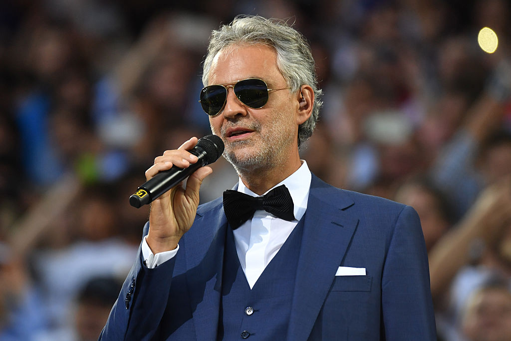 Italian classical singer Andrea Bocelli performs ahead of the start of the UEFA Champions League final football match between Real Madrid and Atletico Madrid at San Siro Stadium in Milan, on May 28, 2016. / AFP / GERARD JULIEN (Photo credit should read GERARD JULIEN/AFP/Getty Images)