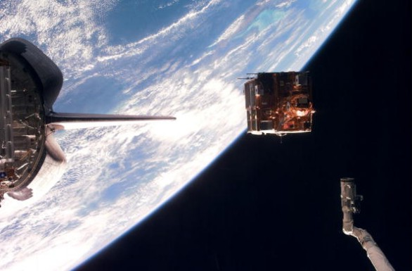 Backdropped Against The Blackness Of Space And Earth's Horizon Spartan 201 5 Leaves The Cargo Bay