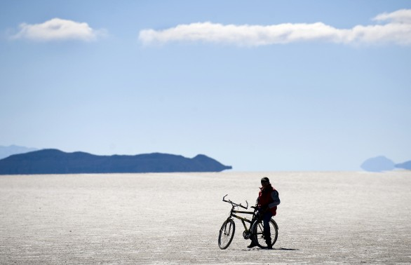 A tourist is seen on a bicycle in the Uy
