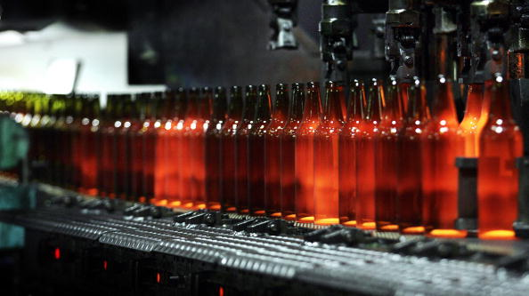 Still glowing glass bottles are seen at