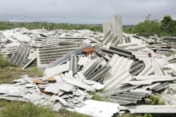 Sheets of roofing containing asbestos lay abandone