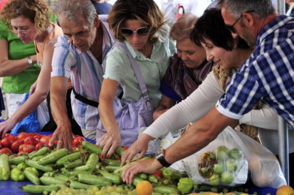 People choose free vegetables offered by