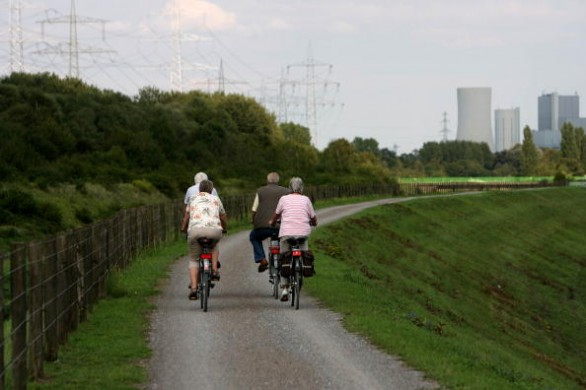 Cyclists make their way on a path in Her