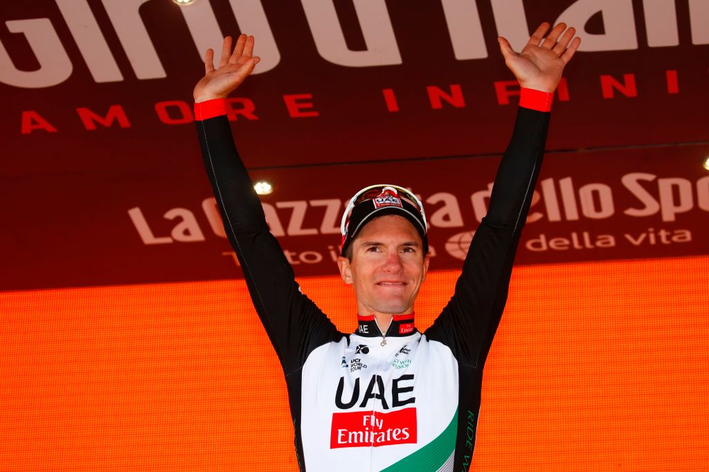 Slovenian Jan Polanc of team UAE celebrates on the podium after winning the 4th stage of the 100th Giro d'Italia, Tour of Italy, cycling race from Cefalu to Etna volcano, on May 9, 2017 in Sicily.  Slovenian Jan Polanc conquered the prestigious Giro d'Italia fourth stage to Mount Etna on Tuesday as Luxembourg's Bob Jungels took the race leader's pink jersey. / AFP PHOTO / Luk BENIES        (Photo credit should read LUK BENIES/AFP/Getty Images)