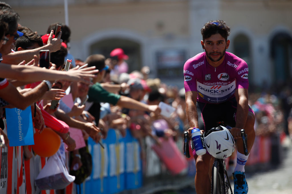 Cyclamen jersey, Colombia's Fernando Gaviria of team Quick-Step, arrives to take the start of the 8th stage of the 100th Giro d'Italia, Tour of Italy, cycling race from Molfetta to Peschici on May 13, 2017.  / AFP PHOTO / Luk BENIES        (Photo credit should read LUK BENIES/AFP/Getty Images)
