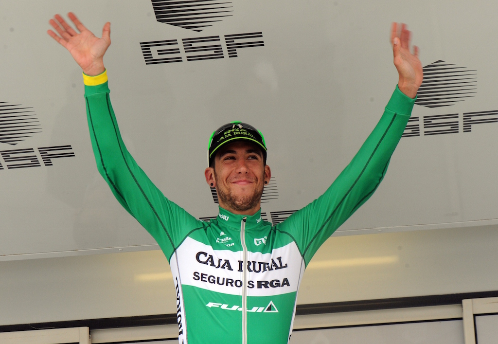 Spain's Omar Fraile celebrates on the podium of the fourth stage of the Four days of Dunkirk cycling race, on May 9, 2015 in Cassel. AFP PHOTO / FRANCOIS LO PRESTI        (Photo credit should read FRANCOIS LO PRESTI/AFP/Getty Images)