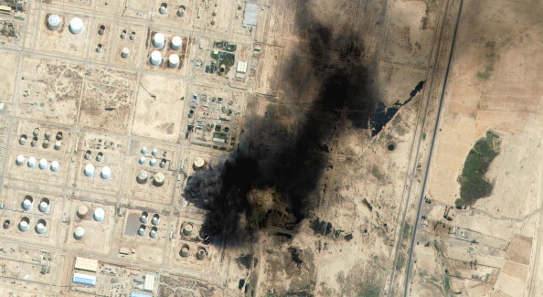 On June 26, 2014, DigitalGlobe's QuickBird Satellite captured this image over Baiji, Iraq, showing the countrys largest oil refinery on fire.