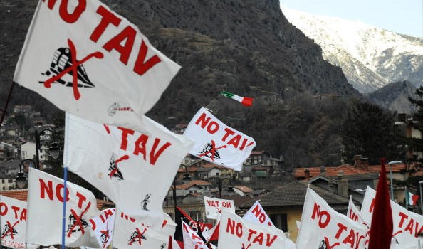 """Flags printed with """"NO TAV"""" are held up"""