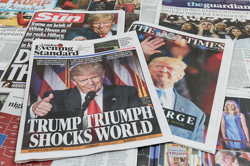 LONDON, ENGLAND - NOVEMBER 09: UK newspapers The Sun, The Times and The Evening Standard feature Donald Trump's victory in the US Presidential elections on their front pages on November 9, 2016 in London, England. The American public have voted for the Republican candidate Donald Trump to be the 45th President of the United States. After 46 of the 50 States declared he had 278 of the 538 electoral college votes and Hillary Clinton conceded defeat in a telephone call. British Prime Minister Theresa May congratulated Trump releasing a statement promising to work with him to build on the special relationship between the UK and the USA. (Photo by Tristan Fewings/Getty Images)