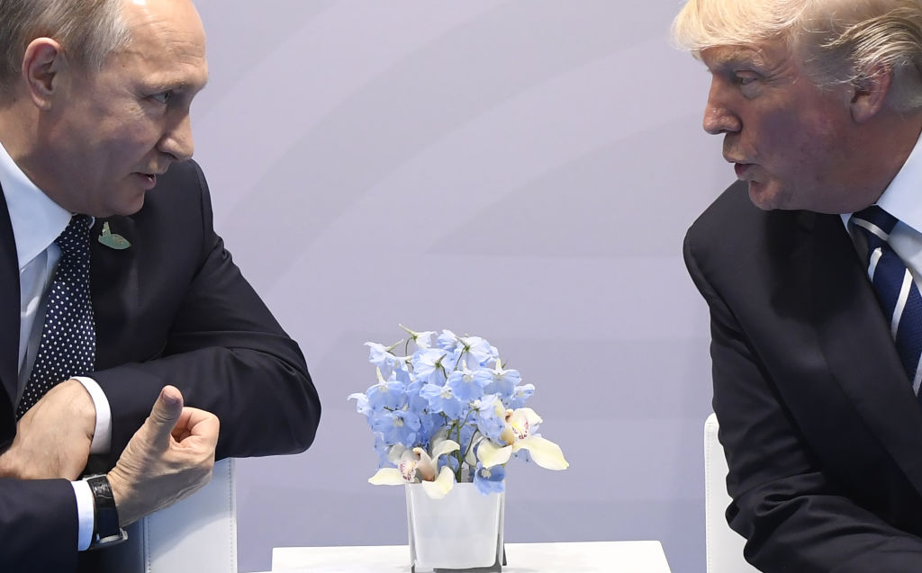 US President Donald Trump (R)and Russian President Vladimir Putin hold a meeting on the sidelines of the G20 Summit in Hamburg, Germany, July 7, 2017. / AFP PHOTO / SAUL LOEB        (Photo credit should read SAUL LOEB/AFP/Getty Images)