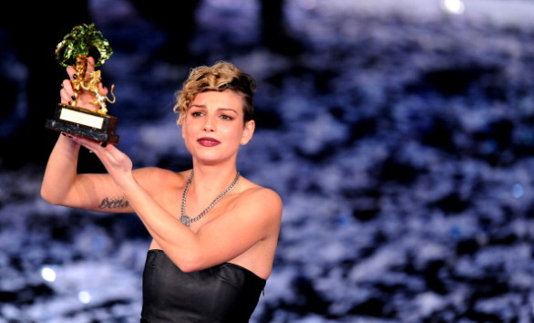 Italian singer Emma poses with her prize