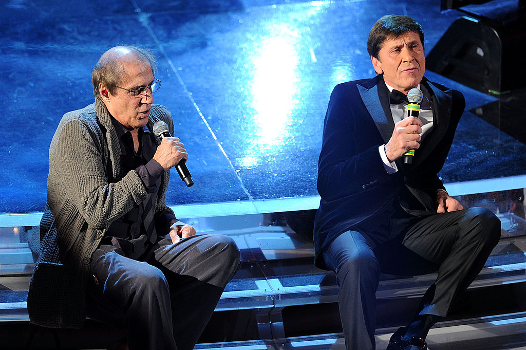 SANREMO, ITALY - FEBRUARY 18:  Gianni Morandi and Adriano Celentano performs on stage at the closing night of the 62th Sanremo Song Festival at the Ariston Theatre on February 18, 2012 in Sanremo, Italy.  (Photo by Daniele Venturelli/Getty Images)