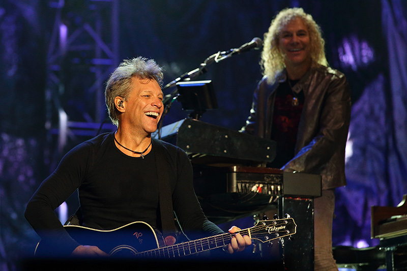 SINGAPORE - SEPTEMBER 20:  (L-R) Musicians Jon Bon Jovi and David Bryan of Bon Jovi performs live on stage on Day 3 at the Singapore Formula One Grand Prix at Marina Bay Street Circuit on September 20, 2015 in Singapore.  (Photo by Suhaimi Abdullah/Getty Images)